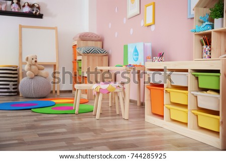Beautiful interior of game room in kindergarten #744285925