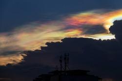 Beautiful iridescent cloud, Irisation. Skyscraper background.