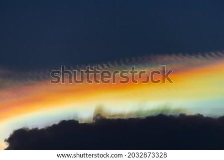 Beautiful iridescent cloud, Irisation. Skyscraper background. Photo stock ©