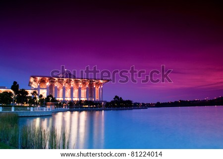 Beautiful Islamic Mosque Beside a Lake at Dusk
