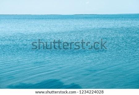 Beautiful island seaside panorama.Instagram film filter.Marine green color.Crystal ocean water surface in idyllic travel destination.