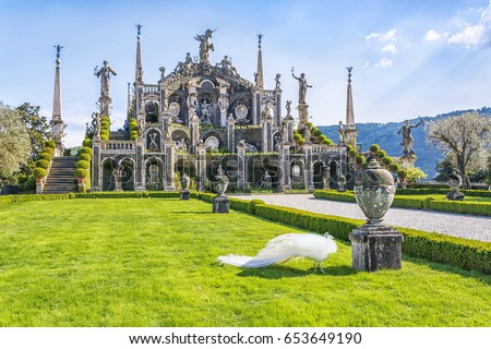 Beautiful Isola Bella island with flower garden, white peacocks and baroque statues, Lake Maggiore, Stresa, Italy.