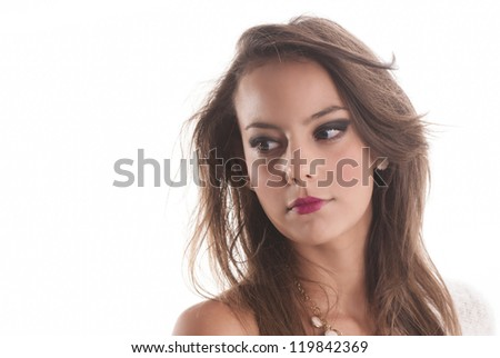 Beautiful isolated woman portrait looking left on white background