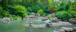 Beautiful Japanese garden with a pond in panorama format