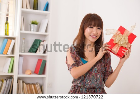beautiful japanese woman happy receiving gift with lifestyle background