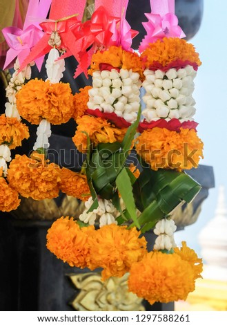 Beautiful Jasmine Wreaths or Garlands with Red Roses Blossoms and Yellow Marigold on The Pink Ribbon, The Garland in Thai Tradition Style. #1297588261