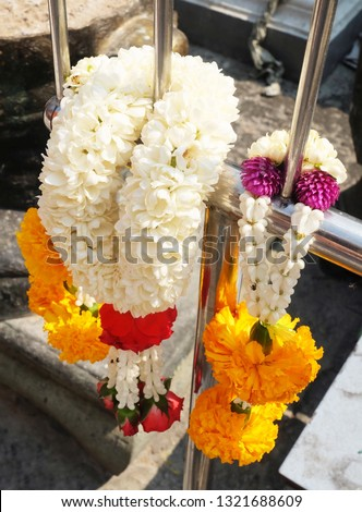 Beautiful Jasmine Wreaths or Garlands with Yellow Marigold and Rose Flowers, The Garland in Thai Tradition Style Used to Pay Respect to The Buddha. #1321688609