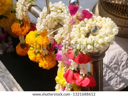 Beautiful Jasmine Wreaths or Garlands with Yellow Marigold and Rose Flowers, The Garland in Thai Tradition Style Used to Pay Respect to The Buddha. #1321688612