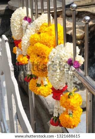 Beautiful Jasmine Wreaths or Garlands with Yellow Marigold and Rose Flowers, The Garland in Thai Tradition Style Used to Pay Respect to The Buddha. #1321688615