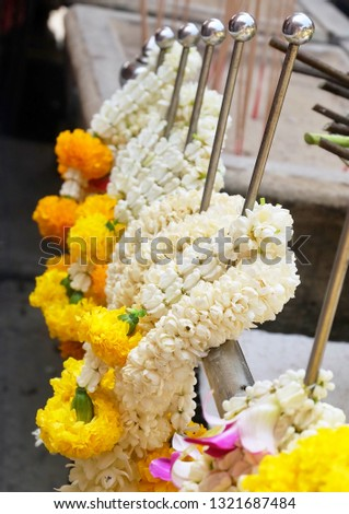 Beautiful Jasmine Wreaths or Garlands with Yellow Marigold Flowers, The Garland in Thai Tradition Style Used to Pay Respect to The Buddha. #1321687484