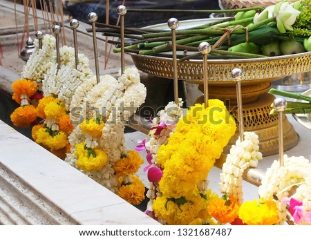 Beautiful Jasmine Wreaths or Garlands with Yellow Marigold Flowers, The Garland in Thai Tradition Style Used to Pay Respect to The Buddha. #1321687487