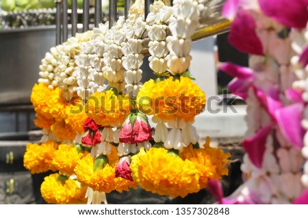 Beautiful Jasmine Wreaths or Garlands with Yellow Marigold Flowers, The Garland in Thai Tradition Style Used to Pay Respect to The Buddha. #1357302848