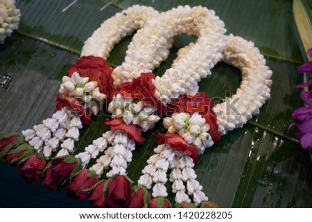 Beautiful Jasmine Wreaths or Garlands with Yellow Marigold Flowers, The Garland in Thai Tradition Style Used to Pay Respect to The Buddha. #1420228205