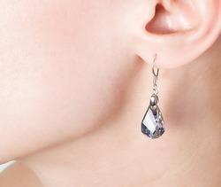 Beautiful  jewellery ear-ring in an ear of young woman