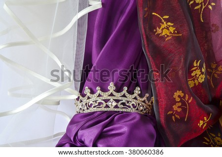 Beautiful jewelry with diamond stones on precious cloths purple and red/Song of songs/The bride of Solomon