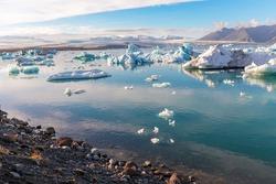 Beautiful Jokulsarlon glacier lagoon, view of icebergs floating, Iceland scenery