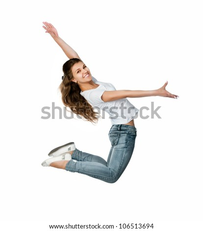 Beautiful jumping girl isolated on white background