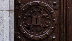Beautiful keyhole on old wooden doors close up