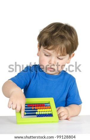 Beautiful kid at the table with an abacus - isolated over a white background.