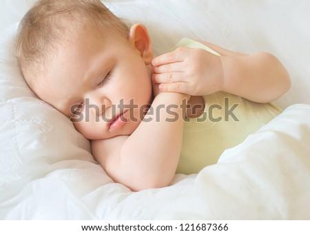 beautiful kid's sleeping, face closeup, studio shot