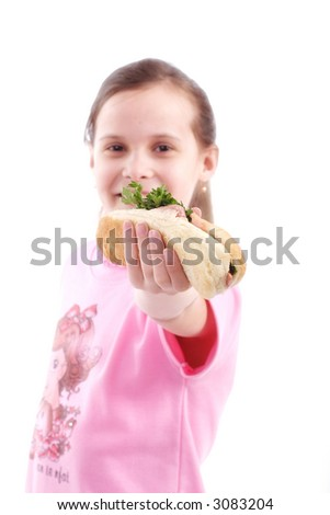 Beautiful kid with hot dog. Shot in studio. Isolated on white.