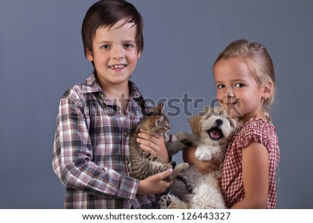 Beautiful kids with their lovely pets - portrait