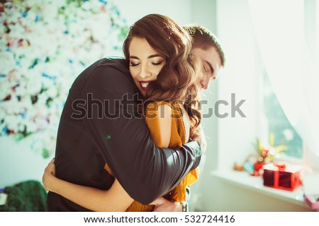 Beautiful lady leans to man's shoulder while he hugs her #532724416