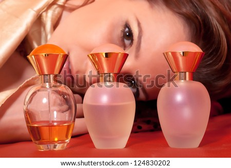 Beautiful lady looking at her perfumes.