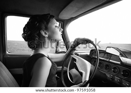 Beautiful lady sitting in a retro car