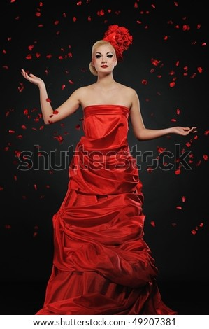 Beautiful lady under flower rain