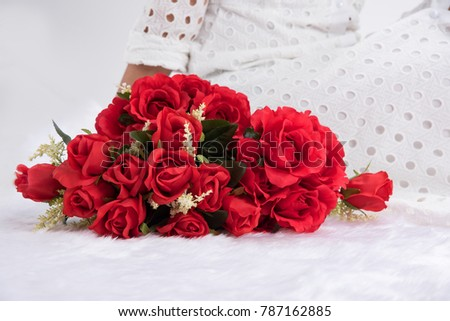 Beautiful lady wear white dress. With rose in red color on white fur cloth. Rose for tell love someone,special day, Valentine's day. #787162885