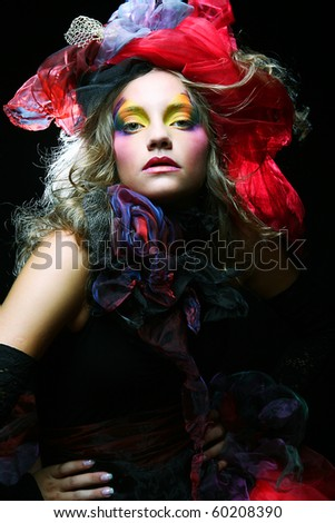 Beautiful lady with artistic make-up. Princess style.