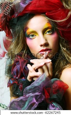 Beautiful lady with artistic make-up. Princess style.