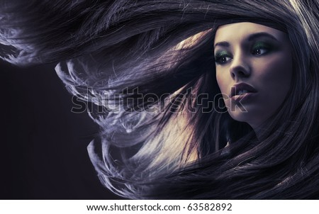 Beautiful lady with long brown hair, at moonlight