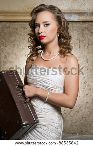 beautiful lady with vintage case  in retro style