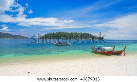 beautiful lagoon with longtail boat. thailand