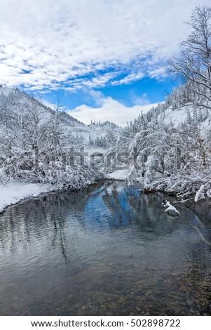 Beautiful lake Amut in taiga hills on Far East of Russia in early october. Mountain lake in winter. Beautiful nature. #502898722