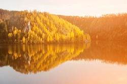 Beautiful lake and autumn forest in the mountains