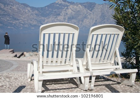 Beautiful lake  beach with armchairs