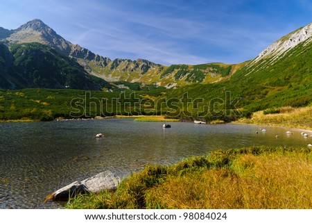Beautiful lake in autumn colors in Tatra Mountains, Slovakia - stock photo