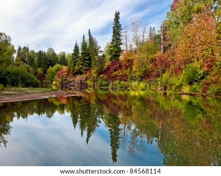 Beautiful lake in the autumn forest