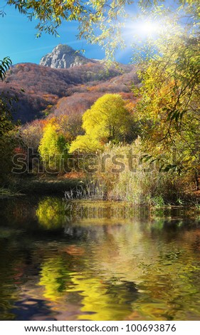 Beautiful lake in the majestic autumn forest. Crimea, Ukraine.