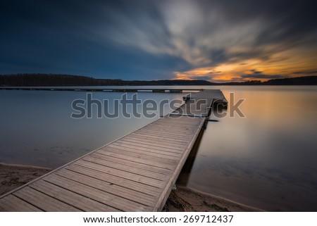 Beautiful lake landscape with vibrant sunset. Long exposure landscape.
