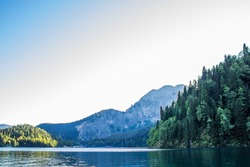 Beautiful lake ritsa in Abkhazia. Landscape of the mountains of the forest and the lake