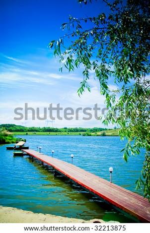 Beautiful lake scene of a wooden pier