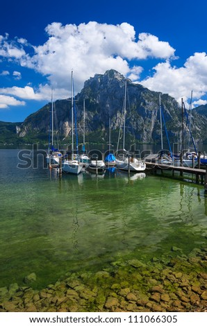 Beautiful lake with boats and yachts in the marina and mountains in the background, Gmunden, Traunsee, Upper Austria