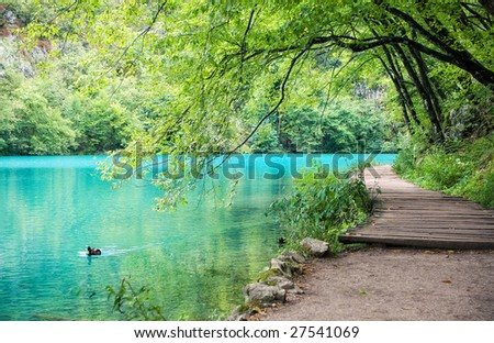 Beautiful  lake with turquoise water - stock photo