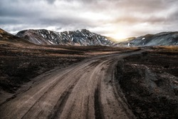 Beautiful Landmanalaugar gravel dust road way on highland of Iceland, Europe. Muddy tough terrain for extreme 4WD 4x4 vehicle. Landmanalaugar landscape is famous for nature trekking and hiking.