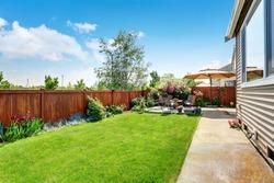 Beautiful landscape design for backyard garden and patio area on concrete floor. Northwest, USA