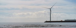 Beautiful landscape. Gran Canaria island. Wind turbines as alternative eco-friendly energy source near the Atlantic ocean. Concept of the beauty in nature. The theme of caring for the environment.
